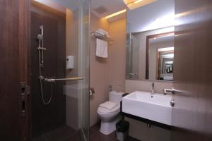 A bathroom at Likas Square Serviced Apartment