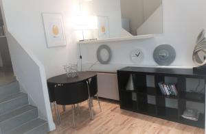 A kitchen or kitchenette at Stylish studio with mezzanine 5 min to the tube