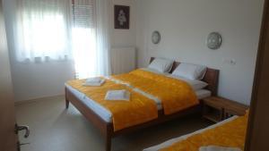 Postelja oz. postelje v sobi nastanitve Apartma Šmid