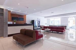 Area lobi atau resepsionis di Blubay Apartments by ST Hotels
