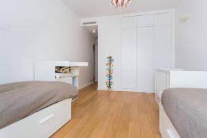 Ein Bett oder Betten in einem Zimmer der Unterkunft CMG Luxury Marais