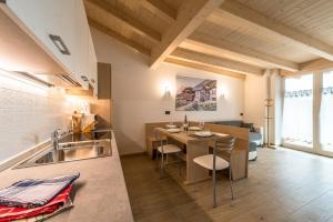Küche/Küchenzeile in der Unterkunft Attico Elbetina