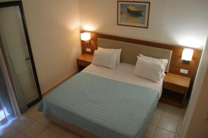 A bed or beds in a room at Christina Beach Hotel