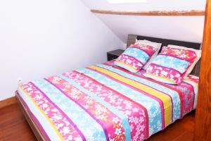 Un ou plusieurs lits dans un hébergement de l'établissement Maison de village Salency
