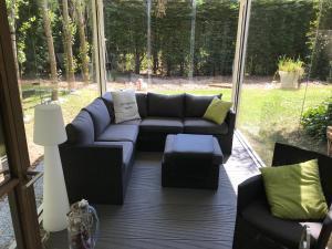 Ein Sitzbereich in der Unterkunft Holiday Home New Largo