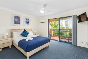 A bed or beds in a room at Bella Mare Beachside Apartments