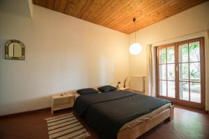 Cama ou camas em um quarto em Casa Figueirinhas