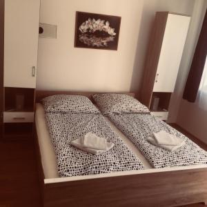 Postel nebo postele na pokoji v ubytování Apartments Tereza
