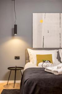 Krevet ili kreveti u jedinici u objektu Monvi Luxury Suites