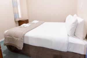 A bed or beds in a room at Aspect Apartments