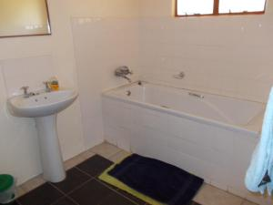 A bathroom at African Sunsets (Bophirimo Self-Catering Guest House)