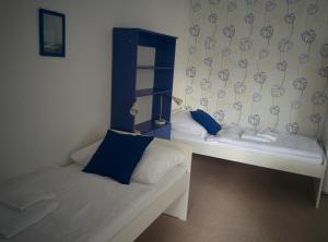 Postel nebo postele na pokoji v ubytování Pension Fontána Svitavy