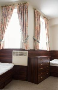 A bed or beds in a room at Top Apartment Ostend