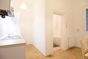 A bed or beds in a room at Vienna Living Apartments - Landstraße
