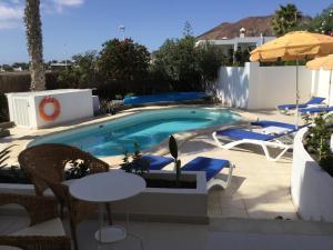 The swimming pool at or near Villa Sol y Luna