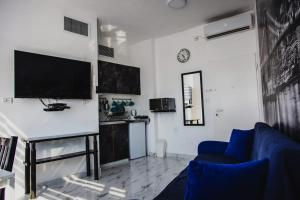 A television and/or entertainment center at Maxus Ashdod Beach Hotel Apartments Sea View