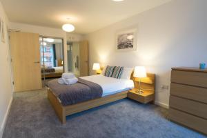 A bed or beds in a room at City Visits - Ryland St.