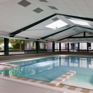 The swimming pool at or near City Shopping - Sleepngo