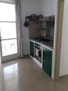 A kitchen or kitchenette at Apartment L Casa Velha