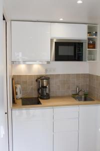 Cuisine ou kitchenette dans l'établissement Studio au charme authentique