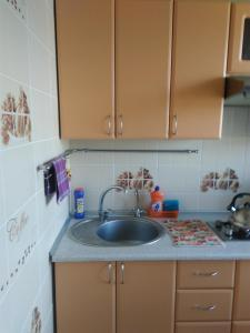 A kitchen or kitchenette at Apartment On Mira 16