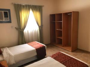 A bed or beds in a room at 6 Al Amoria Apartments