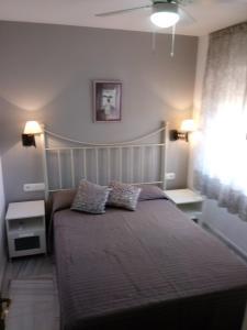A bed or beds in a room at Apartamento Rio Marinas Nerja 46