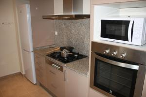 A kitchen or kitchenette at Alguera Apartments Independencia