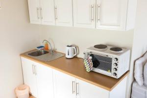 Kuchnia lub aneks kuchenny w obiekcie Hilton Cottage