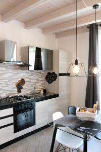 Cucina o angolo cottura di Paradeisos Residence Sas