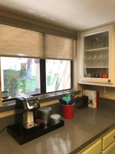 A kitchen or kitchenette at Desert Oasis