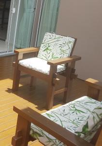 Zona de estar de Casa de Praia em PONTA DAS CANAS, FLORIANÓPOLIS