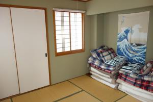 Okinawa Naha Rakuraku Houseにあるシーティングエリア