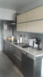 A kitchen or kitchenette at Peaceful City Centre Apartment (2 Bdr)