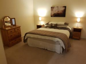 Giường trong phòng chung tại Exclusive retreat