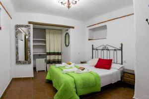 Cama o camas de una habitación en Cuevas El Moral