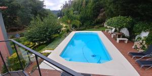 A view of the pool at Quinta das Águias or nearby