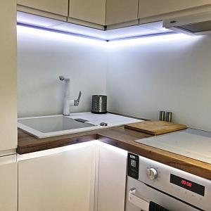 A kitchen or kitchenette at Pure Apartment