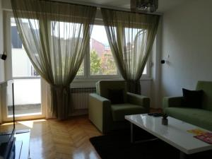 A seating area at Apartman ANE