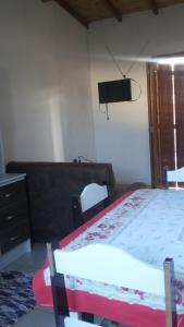A bed or beds in a room at Casa para Verão em Torres