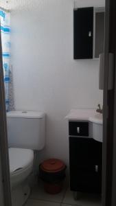 A bathroom at Casa para Verão em Torres