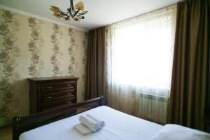 Кровать или кровати в номере Элитная 3-комнатная квартира