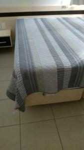 A bed or beds in a room at RIO QUENTE ÁGUAS DA SERRA GO