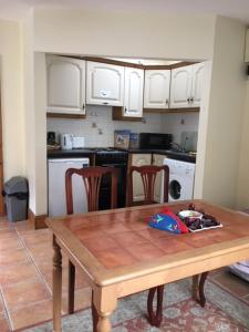 A kitchen or kitchenette at dublin airport apartment