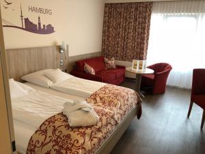 Ein Bett oder Betten in einem Zimmer der Unterkunft Apartment-Hotel Hamburg Mitte