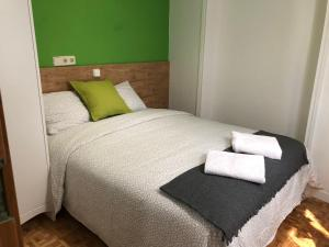 A bed or beds in a room at Apartamentos Villa Latina