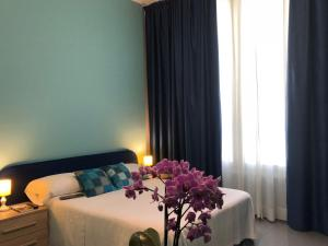 Letto o letti in una camera di Residence Aramis Milan Downtown