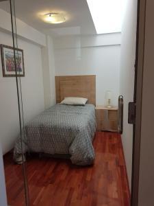 Cama o camas de una habitación en Residencial Altamira