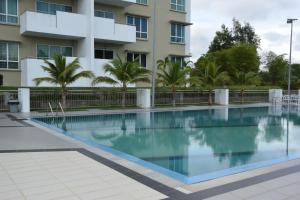 The swimming pool at or near Kein Eco Homestay Miri