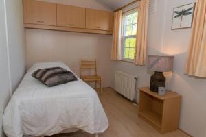 Een bed of bedden in een kamer bij Park Paarlhof 17